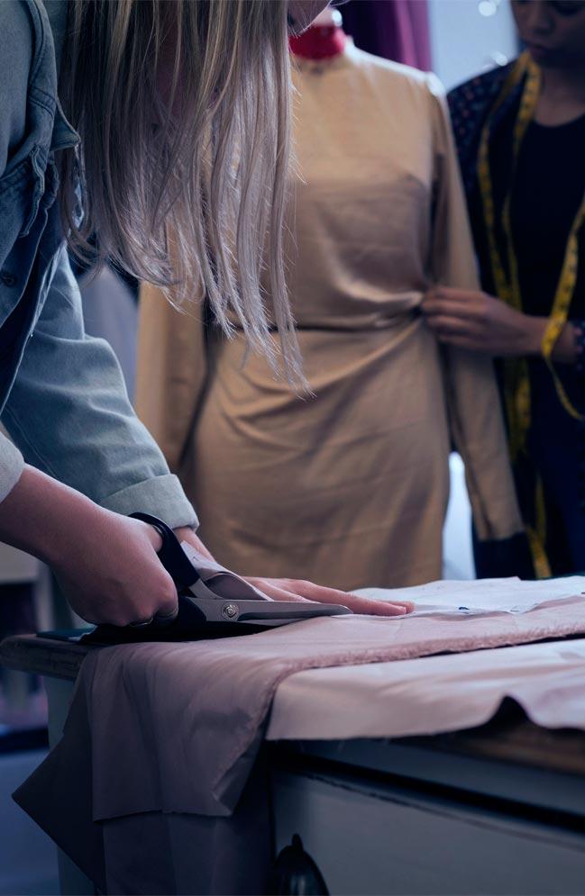 Apprentices cutting cloth